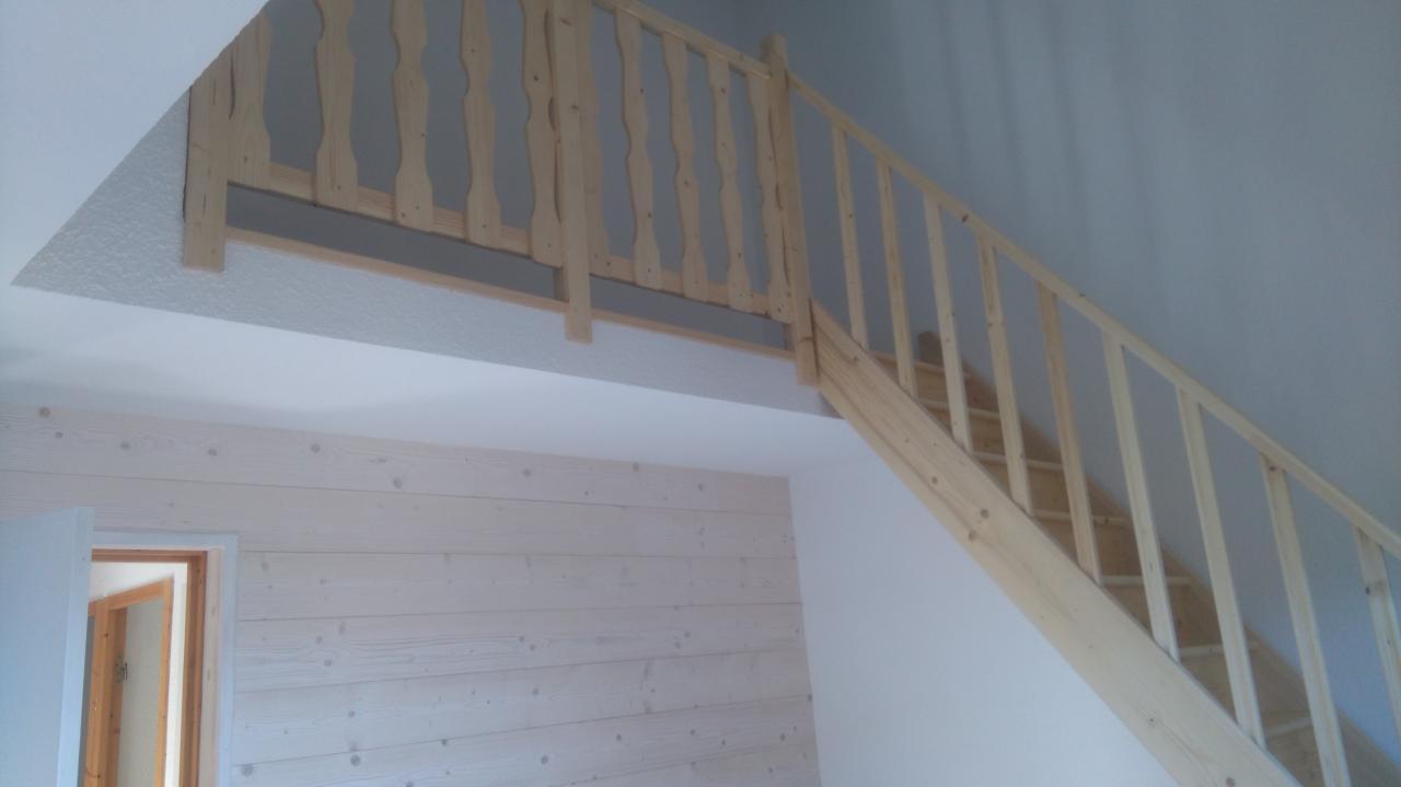 Création d'une mezzanine et mise en place d'un escalier